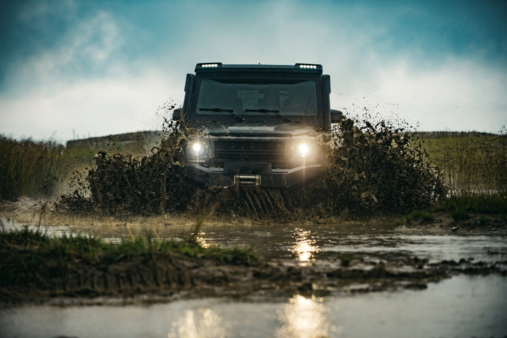 4x4 driving through muddy terrain